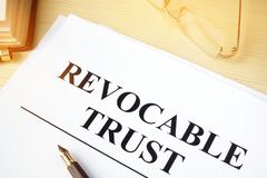 Revocable trust on a desk. Revocable trust on a wooden desk Stock Images