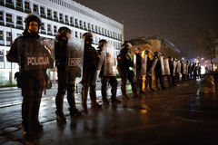 Revolt in Slovenia. 11/27/2012 Ljubljana, Slovenia. Riot police stand guard to prevent protesters to enter the building of the Slovenian parliament in capital Royalty Free Stock Photos