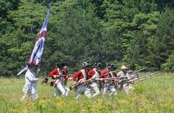 Revoluntary War Reenactors. MCCONNELLS, SC - May 20, 2017:  Revolutionary War reenactors in British uniforms recreate the Battle of Camden at Historic Royalty Free Stock Photos