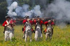 Revoluntary War Reenactors. MCCONNELLS, SC - May 20, 2017:  Revolutionary War reenactors in British uniforms recreate the Battle of Camden at Historic Royalty Free Stock Photography