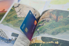 Revolut card and travel book Royalty Free Stock Images