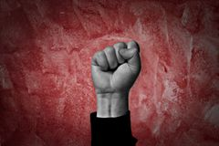 Revolution. Clenched fist held high in protest Stock Photography
