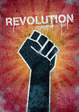 Revolution. Graffiti on a wall with black raised fist