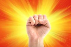 Revolution. Concept of revolution. fist of man on sunny background stock photo