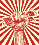 Revolution fist holding money concept Royalty Free Stock Image