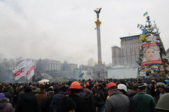Revolution in Kiev, Ukraine. Protesters in Independence Square, Kiev, Ukraine taking part in the revolution which overthrew the President, background of smoke royalty free stock photo