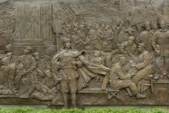 Revolution monument relief at People`s square in Shanghai Royalty Free Stock Images