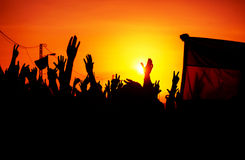 Revolution. People protest against government, man fighting for rights, silhouettes of hands up in the sky, threat of war stock photography