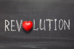 Revolution. Word handwritten on chalkboard with heart symbol instead of O stock photos