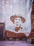 A revolutionaries face on a wall. Creative technique to create an image on a wall in Camaguey, Cuba Stock Photography
