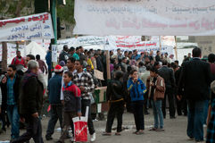 Revolutionaries in Tahrir Square. Waving flags and banners in the square Stock Photography