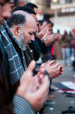 Revolutionaries in Tahrir Square. Revolutionary praying in the streets Stock Images