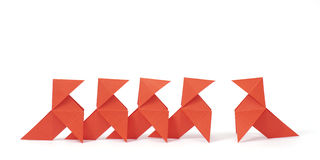 Revolutionary. Five origami birds on white background. Concept of being aginst the crowd / individuality / revolution Royalty Free Stock Photos