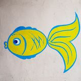 Revolutionary concept. Template. Goldfish on a dirty wall. Fish is carrying out wishes. The wall symbolizes the life of society. Revolutionary concept. Template stock images