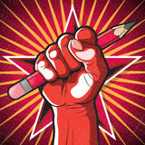 Revolutionary Punching Fist and Pencil Sign. Great illustration of Russian Propaganda style punching Fist holding a pencil symbolising Freedom of speech Royalty Free Stock Photos