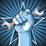 Revolutionary Punching Fist and Spanner Sign. Great illustration of Russian Propaganda style punching Fist holding a Spanner symbolising Workers Rights Stock Photo