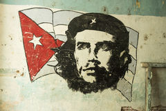 Revolutionary wall painting Che Guevara Havana. Revolutionary romantic wall painting of Che Guevara and the Cuban flag in a gateway in Old Havana (Spanish Stock Photography