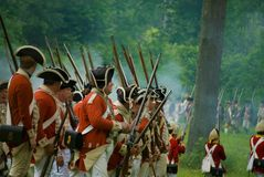 Revolutionary War British Attacking during Battle of Monmouth. The Battle of Monmouth reenactment takes place in June in New Jersey Stock Photo