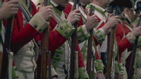 Revolutionary War British soldiers line up. A view of Revolutionary War British soldiers line up stock footage