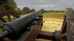Revolutionary War Cannon. The cannon stands guard over a long past battlefield of the revolutionary war, the scars have gone but the cannon stills protects the Stock Photos