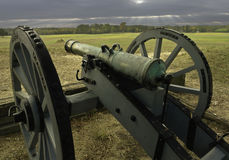 Revolutionary War Cannon. The cannon stands guard over a long past battlefield of the revolutionary war, the scars have gone but the cannon stills protects the Royalty Free Stock Images