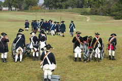 Revolutionary War re-enactors re-create the cannon fire and subsequent cease-fire of the British army, in which they flew the whit Stock Photo
