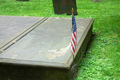 Revolutionary War Veteran. A flag on the tomb of a revolutionary war veteran, at a New York City cemetery stock photography