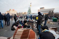 Revolutioners of the anti-government movement sitting on the frosty street during the week of pro-European protest Stock Image