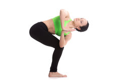 Revolved chair yoga pose Stock Images