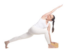 Revolved side angle pose for beginning yoga student Royalty Free Stock Photos