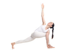 Revolved Side Angle Pose for beginning yoga student Stock Photos