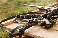 Revolver. Old black powder handgun, rifle and horse reigns Royalty Free Stock Images