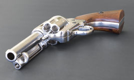 Revolver. A Peacemaker revolver isolated on a black background Stock Image