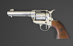 Revolver. A Peacemaker revolver isolated on a black background Royalty Free Stock Photo