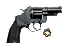 Revolver. Old revolver and six сartridges Stock Photo