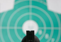 Revolver aimed at target Royalty Free Stock Image