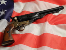 Revolver on American flag Royalty Free Stock Photography