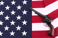 Revolver on an American flag Royalty Free Stock Image