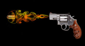 Revolver with bullet on black Royalty Free Stock Photography