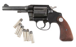 Revolver and bullets. Closeup image of revolver and bullets on white background Royalty Free Stock Photo