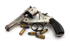 Revolver and bullets. Opened old revolver and 4 bullets on white Stock Photo