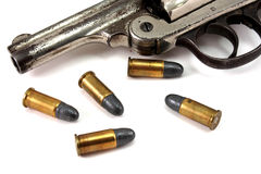 Revolver and Bullets. Old revolver and 4 bullets on white.applogise Royalty Free Stock Image