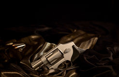 Revolver with Bullets on Satin Royalty Free Stock Photos