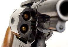 Revolver 38 Caliber Pistol Loaded Cylinder Gun Barrel Pointed. 38 Caliber Revolver Pistol Loaded Cylinder Gun Barrel Close Up Pointed on White Royalty Free Stock Photo
