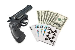 Revolver, cards and money Stock Images