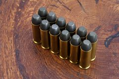 Revolver cartridges .45 Cal Wild West period. On wooden background Stock Photo