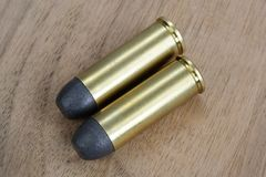 The .45 Revolver cartridges dating to 1872. On wooden background Stock Images