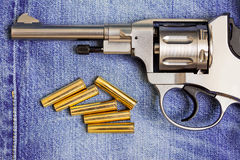 Revolver with cartridges Royalty Free Stock Images
