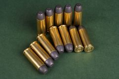 The .45 Revolver cartridges Wild West period. On green background Stock Photos