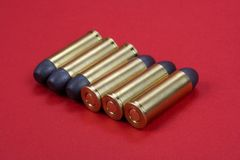 The .45 Revolver cartridges Wild West period. On  red background Royalty Free Stock Photos